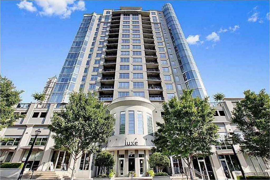 front of Luxe Condominium Building